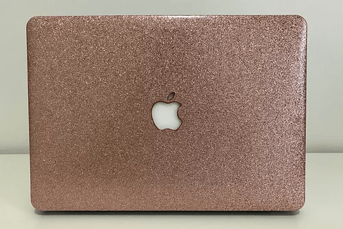 Case para Macbook de glitter rosa.
